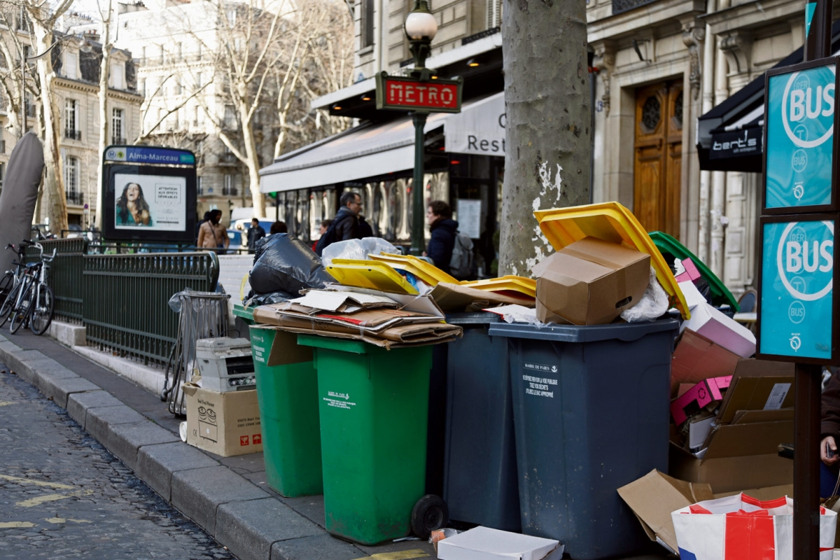 Overflowing trash bins are seen near a metro station as waste incineration plants go on strike in Paris, France
