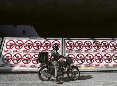 A motorcyclist drives his motorbike past posters on the streets that reads »No to the payment of the debt. Break with the IMF«, in Buenos Aires, Argentina February 22, 2020